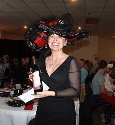 "Winner of the ""Best Hat"" was Cheryl Osting. She won a bottle of wine and a gift certificate."
